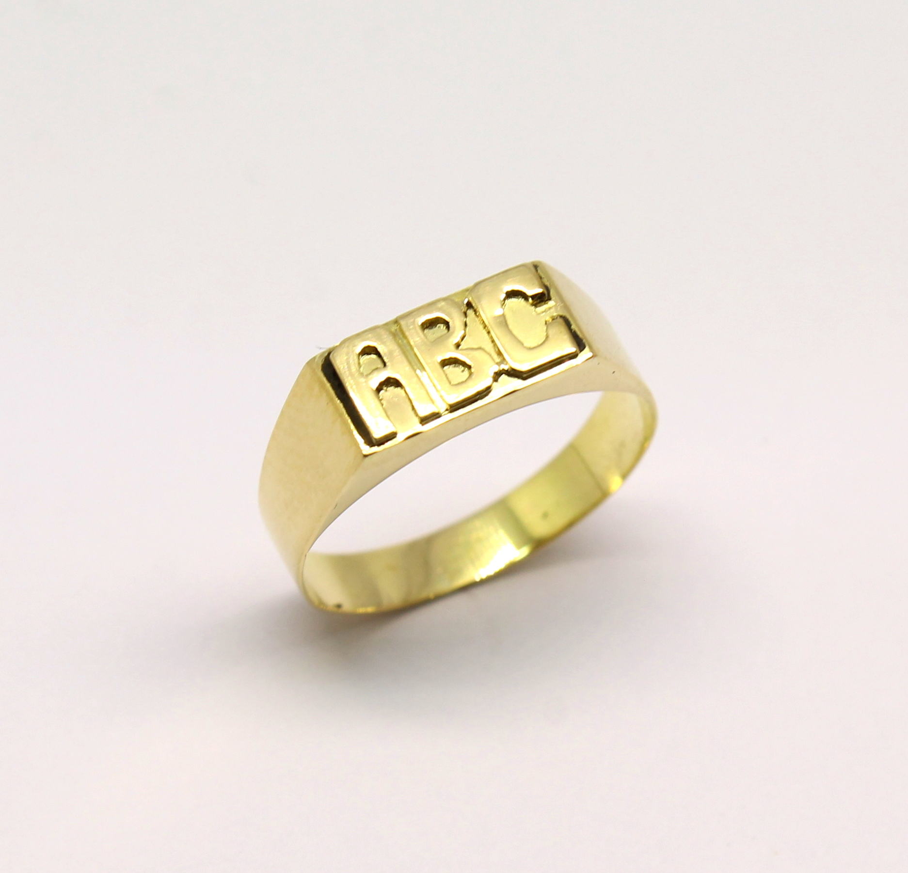 07fb7ff604b Anel Infantil ABC Ouro Amarelo 18k 750 - Marcio Joalheiros   Marcio ...